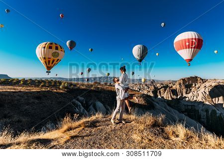 Happy Couple In Cappadocia. The Man Proposed To The Girl. Honeymoon In Cappadocia. Couple At The Bal