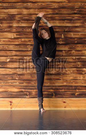 Young Woman Doing A Stretching Exercise Utthita Hasta Padangusthasana Pose