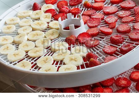 Fresh Strawberry Slices Bananas Prepared For Drying In A Dehydrator