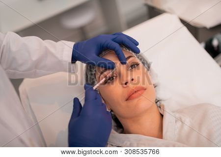 Woman Having Botox Injections While Visiting Beauty Clinic
