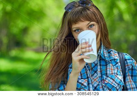 Portrait Young Woman Drinking Coffee In Paper Cup