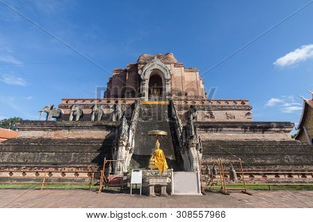 Pagoda And Buddha Statue At Wat Chedi Luang Temple In Chiang Mai Thailand