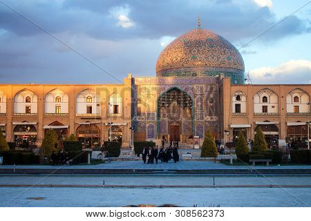 Isfahan, Iran - March 7: People At Imam Square In Fornt Of Sheikh Lotfollah Mosque On March 7, 2013