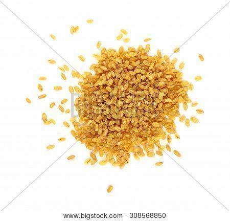 Close Up Heap Of Yellow Traditional Bulgur (bulghur, Burghul) Big Grains Of Durum Wheat, Isolated On