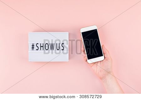 Creative Top View Flat Lay Of Lightbox With Hashtag Show Us Message And Mobile Phone In Hand Mockup