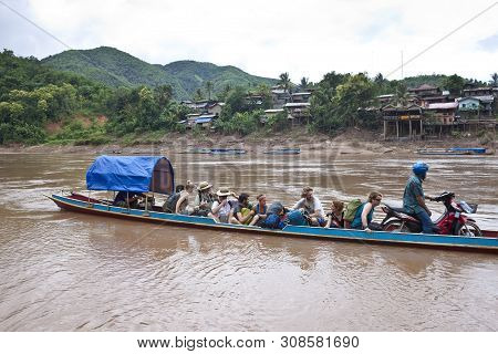 Muang Khua, Laos - August 14: People In River Ferry On August 14, 2012 In Muang Khua, Laos. Muang Kh