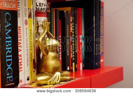 3 June 2019 Eskisehir, Turkey. Yoga Tantra Position Figurine With Copyspace On The Side With Books O