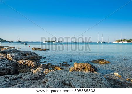 Yachting Paradise, Anchored Sailing Boats And Yachts In The Morning In Blue Bay On Croatian Adriatic
