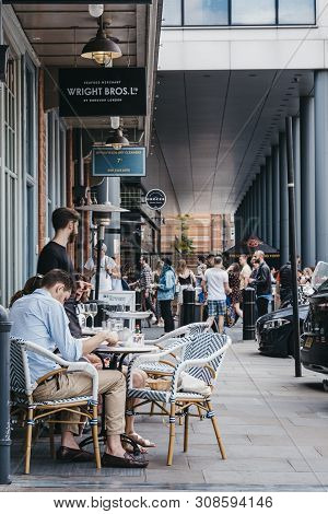 London, Uk - June 22, 2019: People Sitting At Outdoor Tables Of Wright Bros Seafood Restaurant In Sp