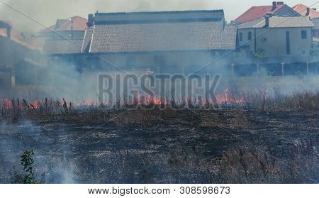 Strong Smoke In Steppe. Forest And Steppe Fires Destroy Fields And Steppes During Severe Droughts. F