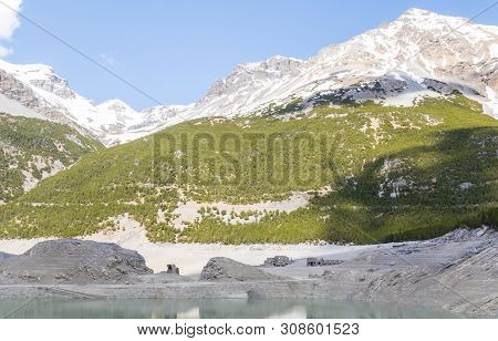 Hydroelectric Site On Alps With Dam And Artificial Lake