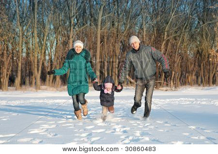Family Running In Park