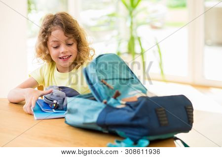 Child Preparing To Shool And Doing His Bag