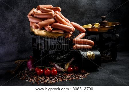 Delicatessen Raw Long Thin Wieners On Antiquarian Scales