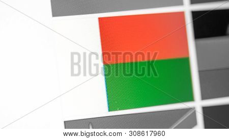 Madagascar National Flag Of Country. Madagascar Flag On The Display, A Digital Moire Effect. News Of
