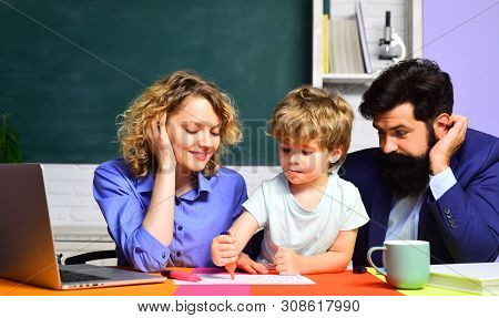 Happy Family. Boy From Elementary School. Mother Father And Son Together Schooling. Back To School A