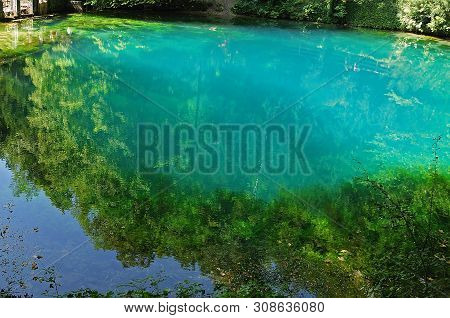 Blautopf, Karstic Spring, Source Of River Blau In Blaubeuren, Germany, With Turquoise Water