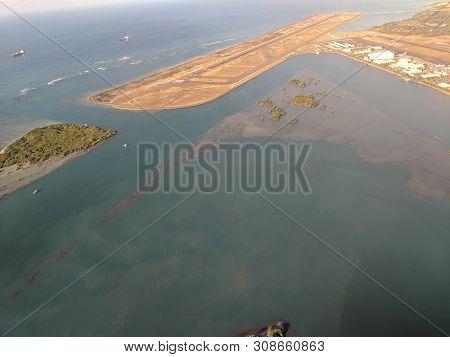Honolulu - October 25, 2018: Aerial Of Airport Reef Runway, Planes And Plane Hangers At Honolulu Int