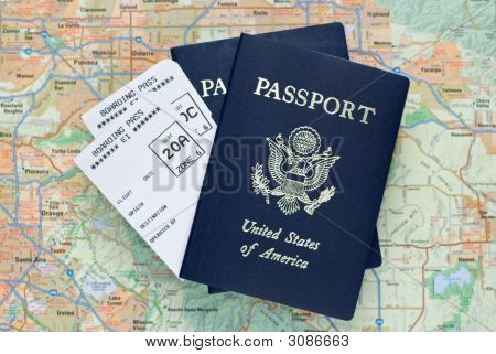 Airplane Boarding Passes And American Passports Over Map