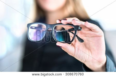 Optician, Optometrist, Oculist Or Eye Doctor Holding Glasses And Specs With New Lenses. Professional