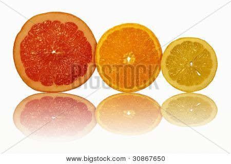 The Sliced Fruit And Their Reflection On A White Background