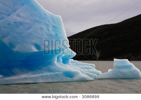 Broken Blue Iceberg At Grey Glacier