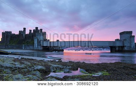 Conwy, Wales, June 11. Conwy Castle On June 11, 2019, In Conwy, Wales. Boats Moored At Low Tide Near
