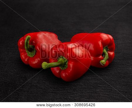 Sweet Red Bell Pepper On Black Background