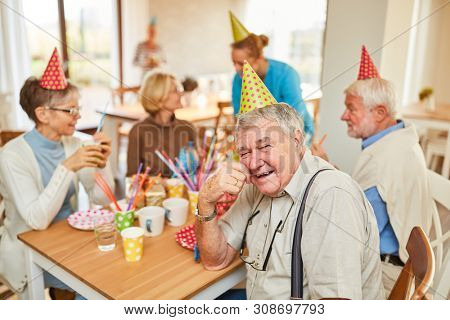 Seniors celebrate birthday together in a retirement home and have fun together