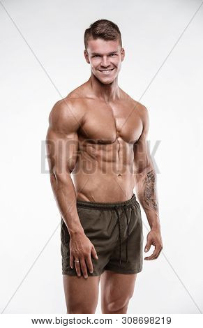 Strong Athletic Man Shows Body