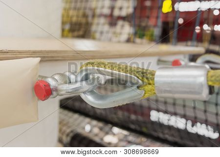Fastening A Yellow Nylon Rope To A Metal Structure Close-up. Equipment In The Obstacle Course