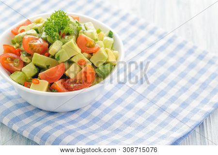 Salsa From Avocado, Cherry Tomatoes And Lime. Traditional Salad From Fresh Vegetables With Avocado.