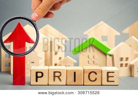 Wooden Blocks With The Word Price, Up Arrow And Wooden Houses. The Increase In Housing Prices. Risin