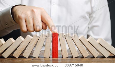 Businessman Stops Collapse Domino Effect. Stress Resistance Business. Financial Stability. Recovery