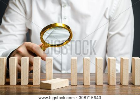 The wooden block fell out of order. The study of business mistakes. Weak link. Unreliable and unsuccessful plan. Risk assessment and strategy creation. Costs and ineffective management. Businessman poster