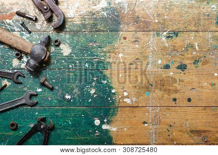 Flat Lay Set Of Vintage Carpentry Tools On Colorful Wooden Background. Top View Workbench With Carpe