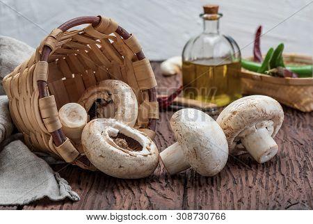 Basket Of Mushrooms (champignon, Cut Feet, Agaricus Bisporus) Raw (uncooked). With Several Ingredien