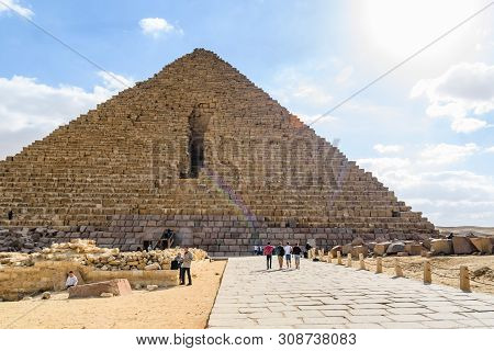 Cairo, Egypt - December 8, 2018: Tourists Near Great Pyramid Of Cheops In Giza Plateau. Cairo, Egypt
