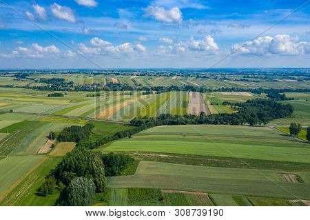 Aerial View Of Farmlands And Mountains In Rural Poland Seen From Drone. Summer Time.