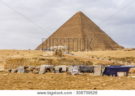Cairo, Egypt - December 8, 2018: View On Great Pyramid Of Cheops And Sphinx In Giza Plateau. Cairo,