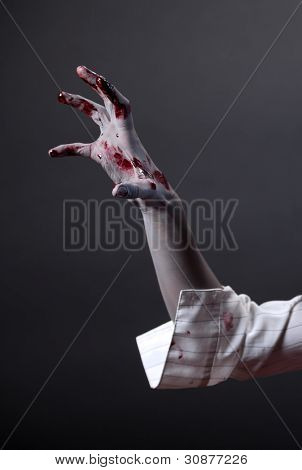 Creepy zombie hand, extreme body-art, studio shot