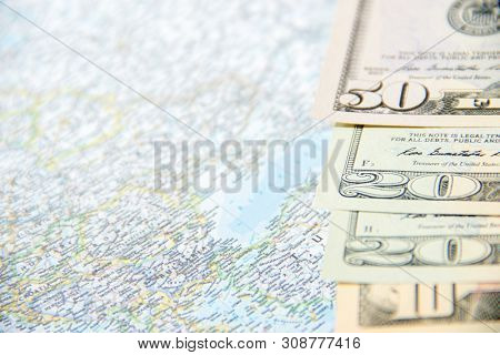 Going To Travel. Money, Hundred Dollars On Map. Save Money On Travel, Planning For Budget Concept. S