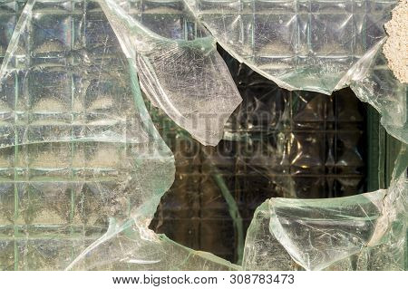 The Thick, Cracked Glass Of A Window. The Thick Glass Partition. Glass Wall Background. Glass Textur