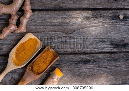Fresh Turmeric And Powder Curcumin On Old Wooden Background, Copy Space