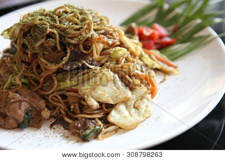Japanese Cuisine, Fried Noodles Yakisoba On A Plate