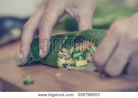 Close Up Of Hands Making Vegetarian Rolls Food. Healthy Food. Vegetarian Food. Nutritious Food. Fema