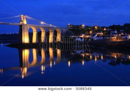 Menai Bridge reflections of the town and Suspension bridge poster