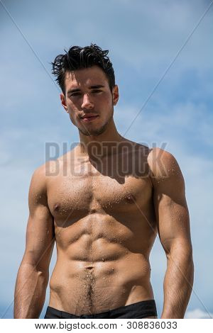 Young Fit Athletic Man At Beach In Summer Day