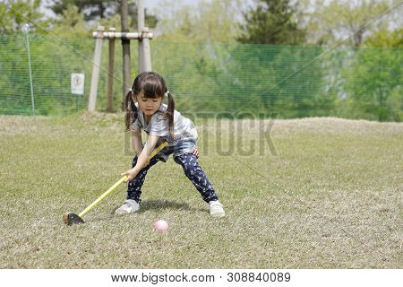 Japanese Girl Playing With Putting Golf (4 Years Old)