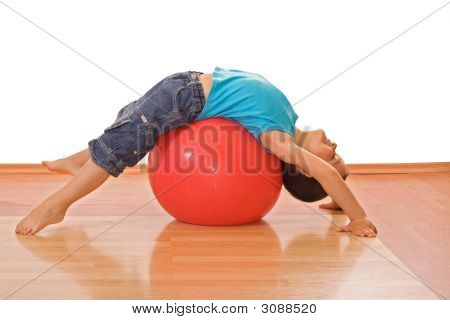 Boy Playing With A Gymnastic Ball